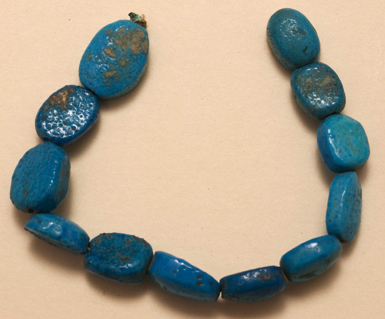 Scaraboid beads