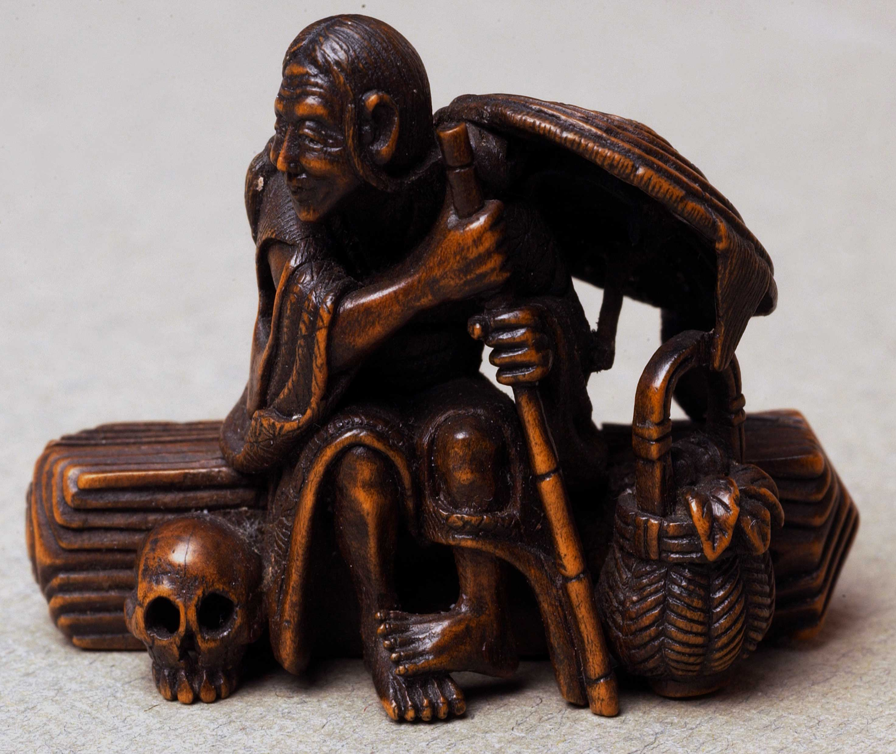 Netsuke depicting a seated man