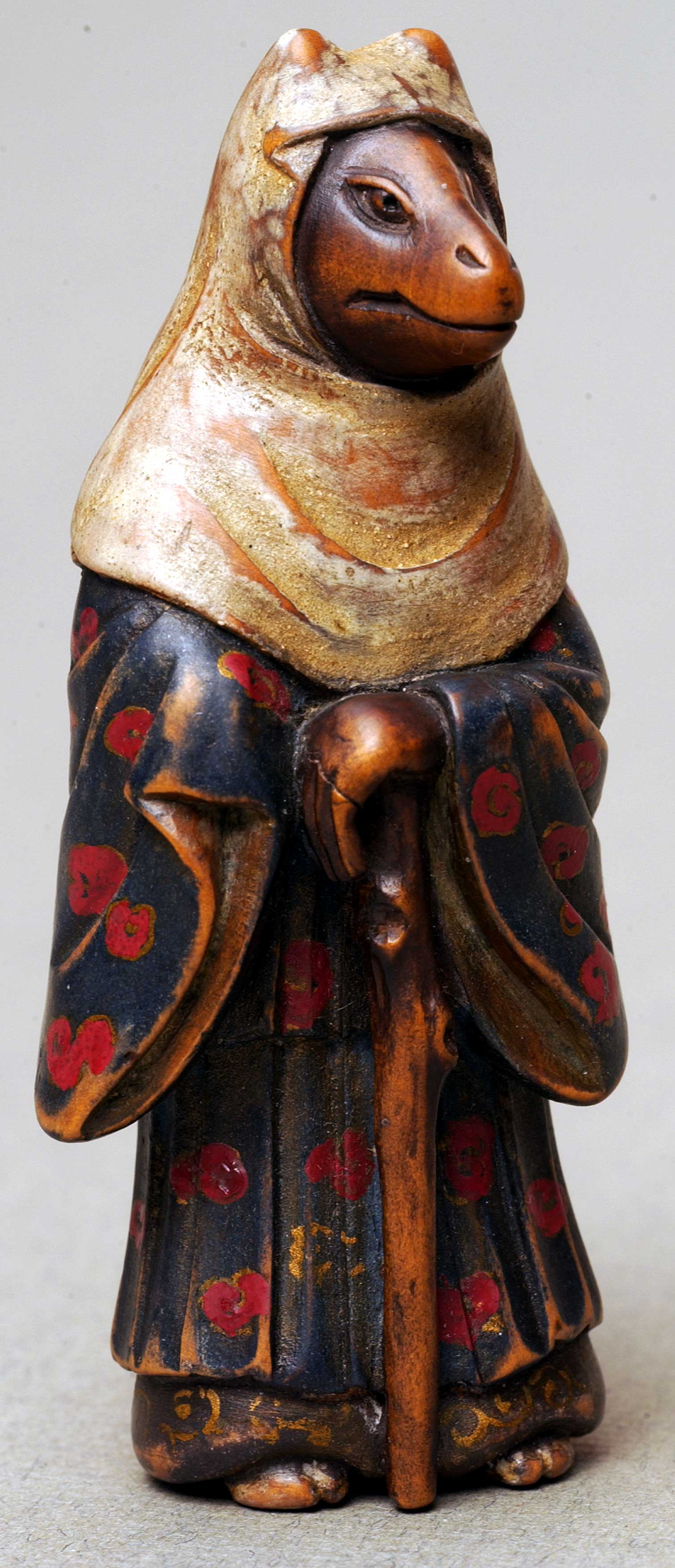 Netsuke depicting fox in dress and cloak