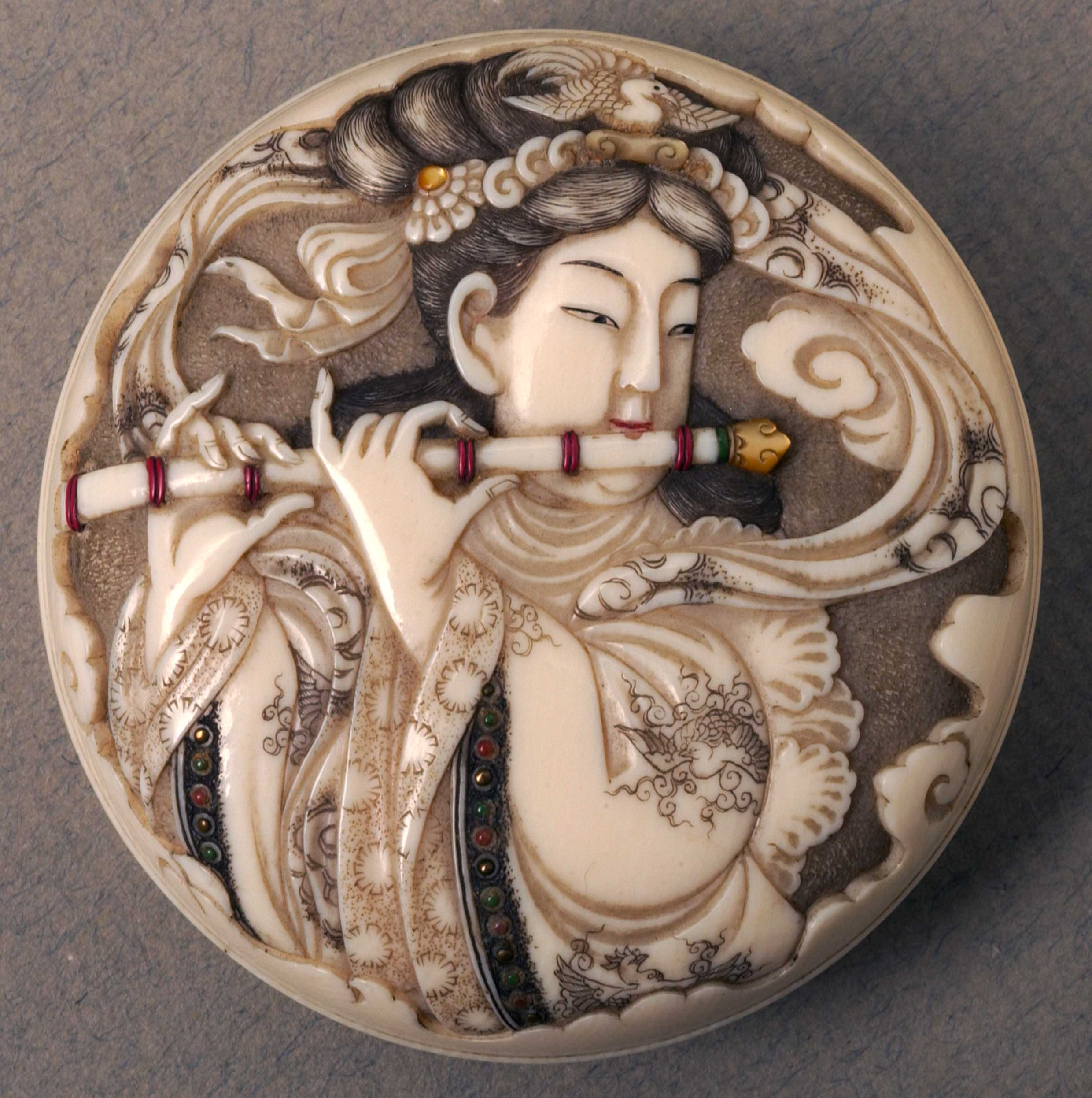 Netsuke depicting a woman playing a flute