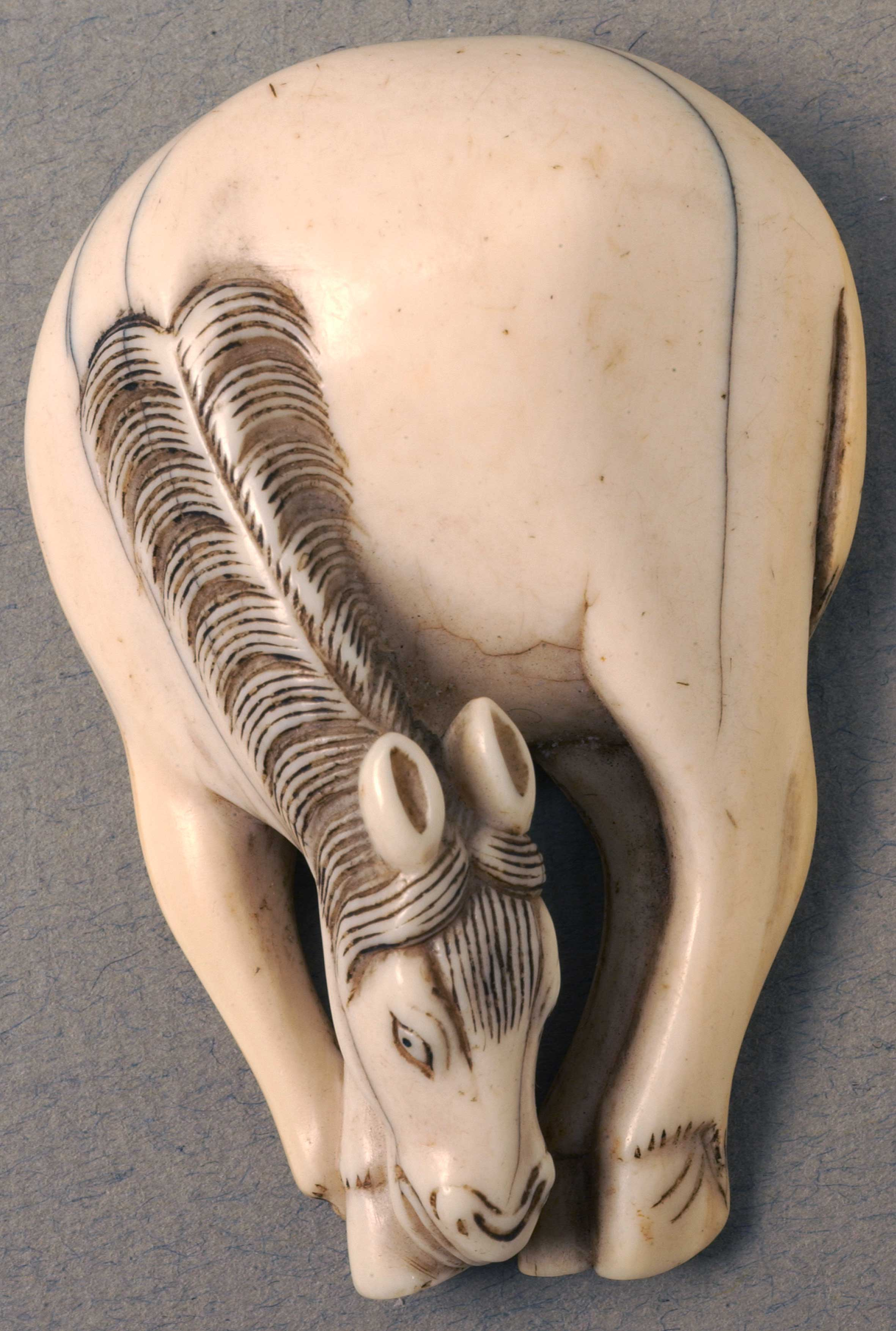 Netsuke depicting a Grazing horse