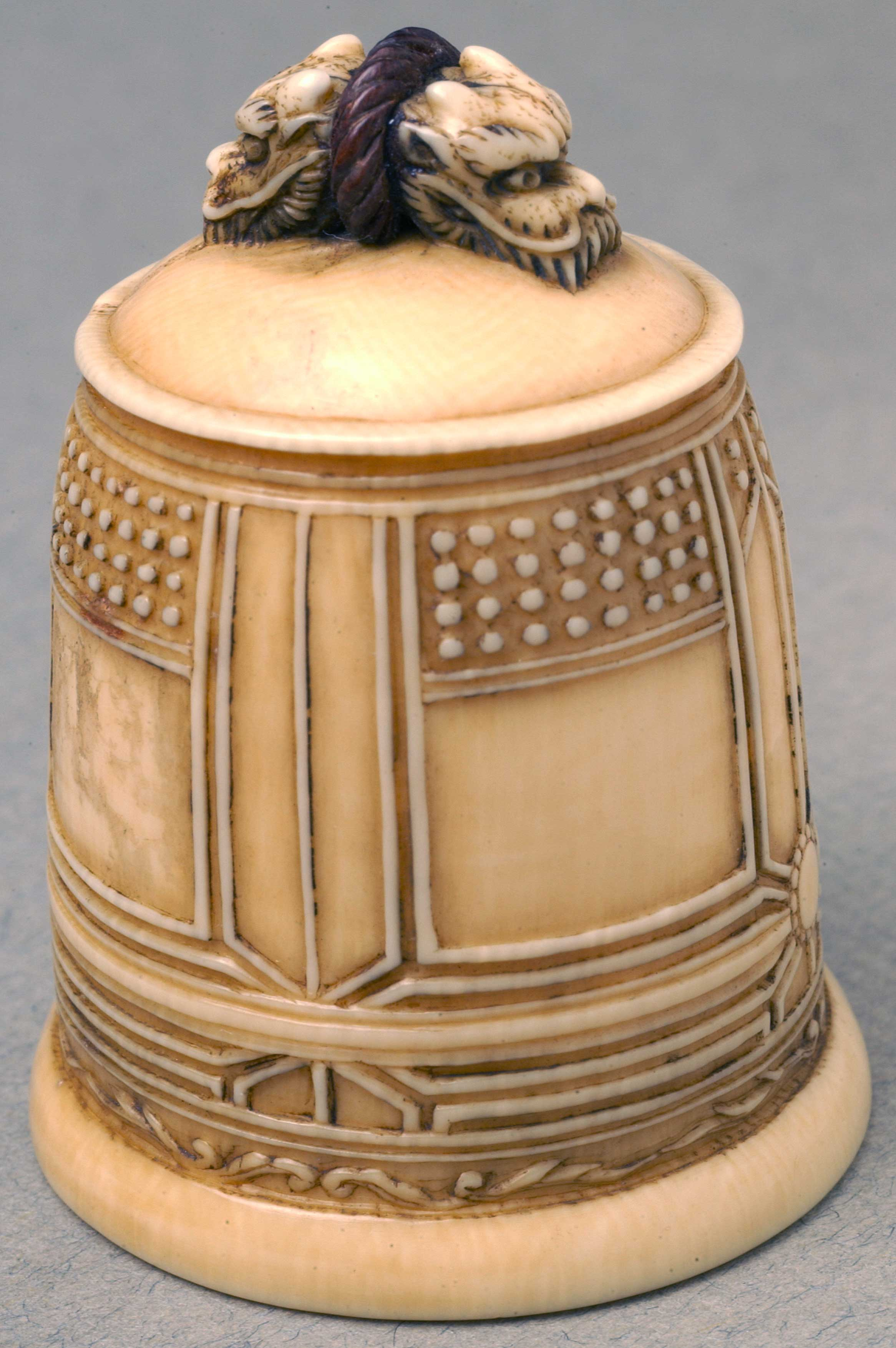 Netsuke depicting a bell with two dragon heads