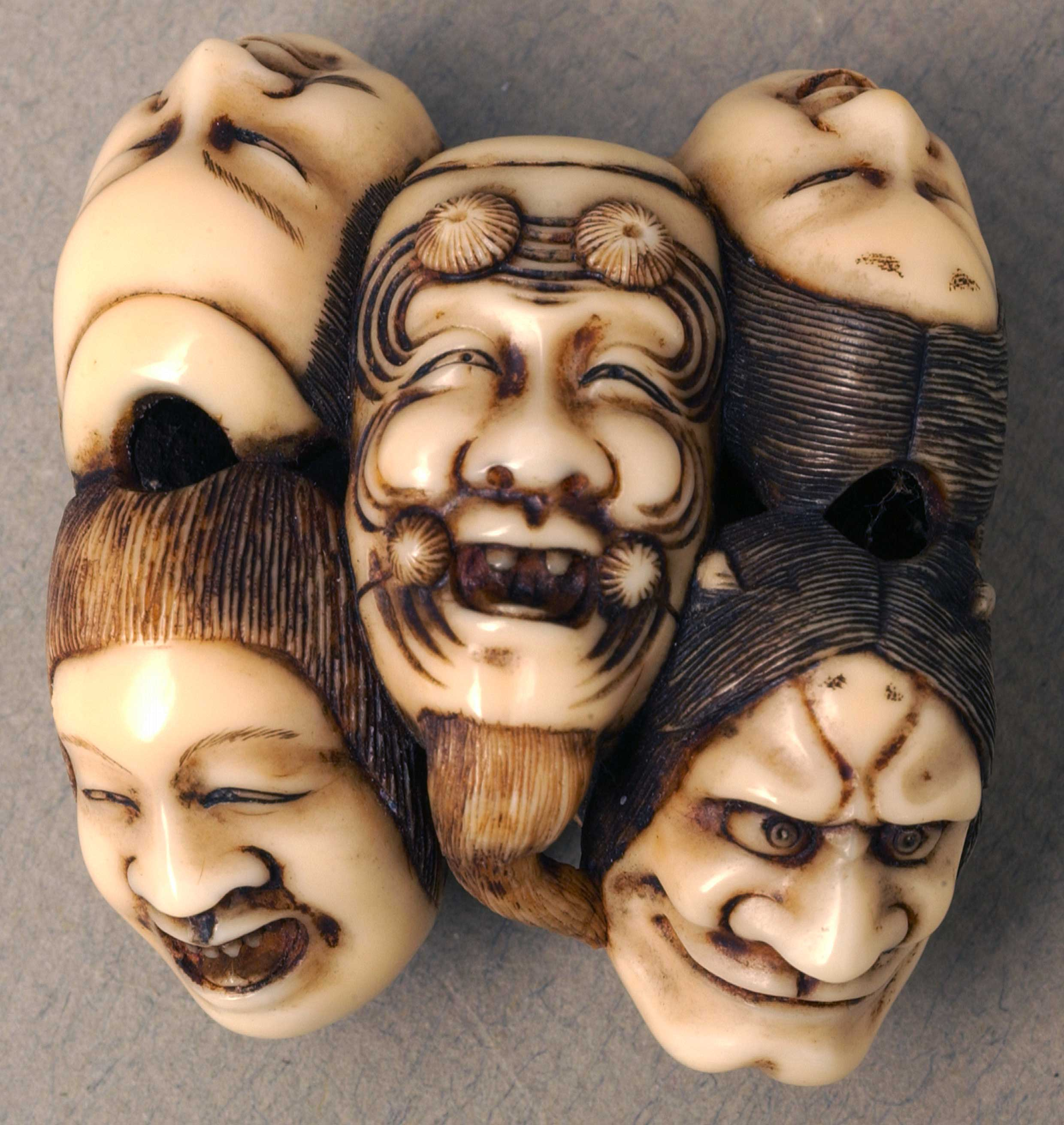 Netsuke depicting seven faces