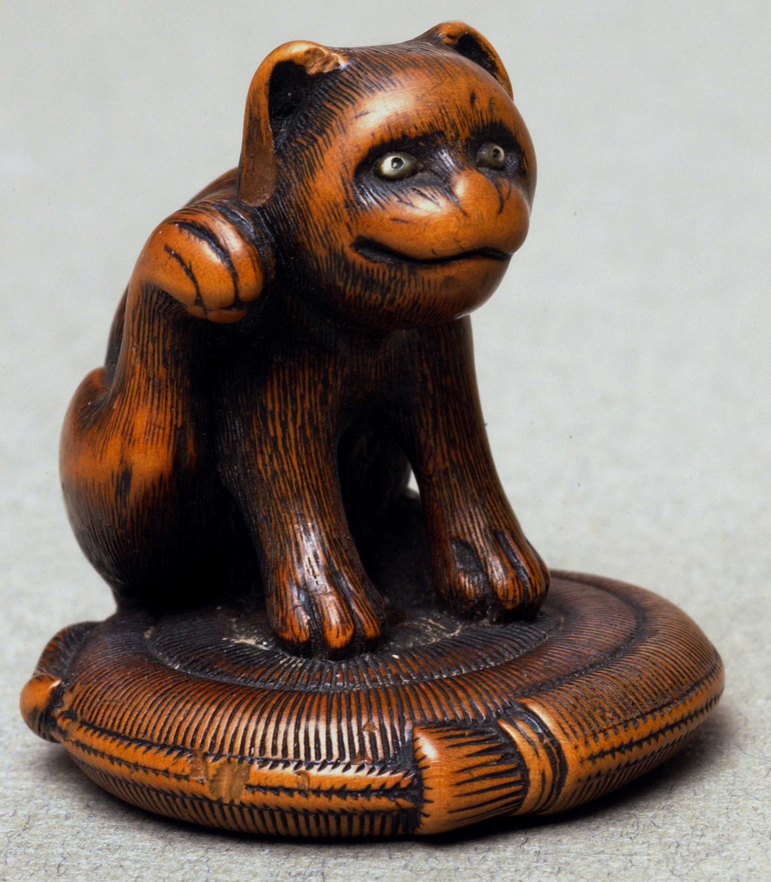 Netsuke depicting a cat scratching ear