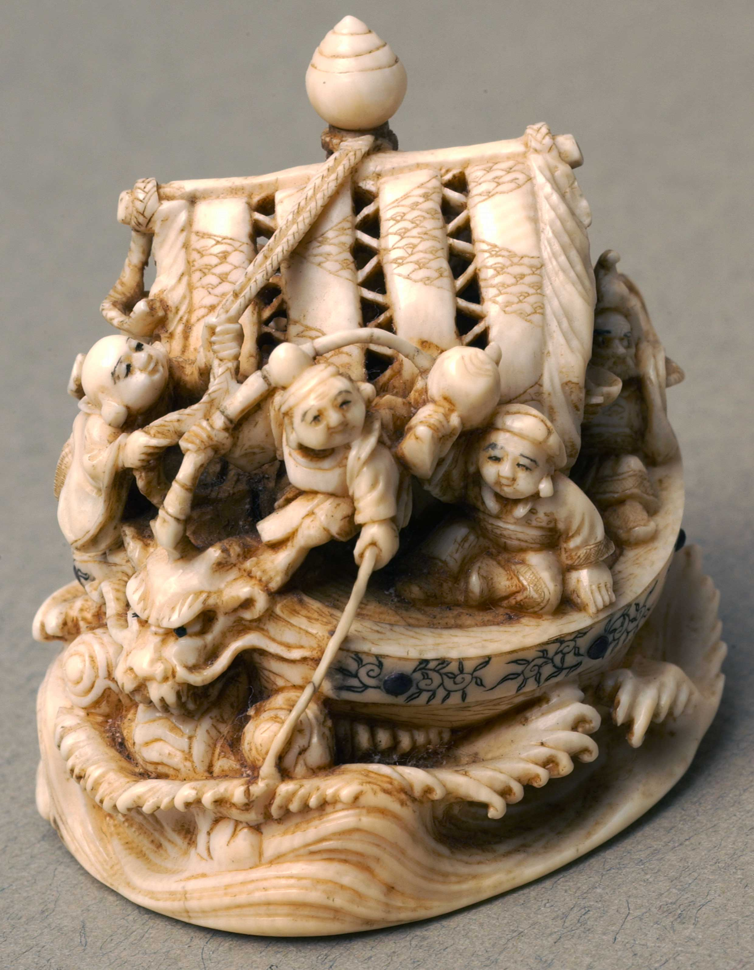 Netsuke depicting sailors in a sea dragon boat