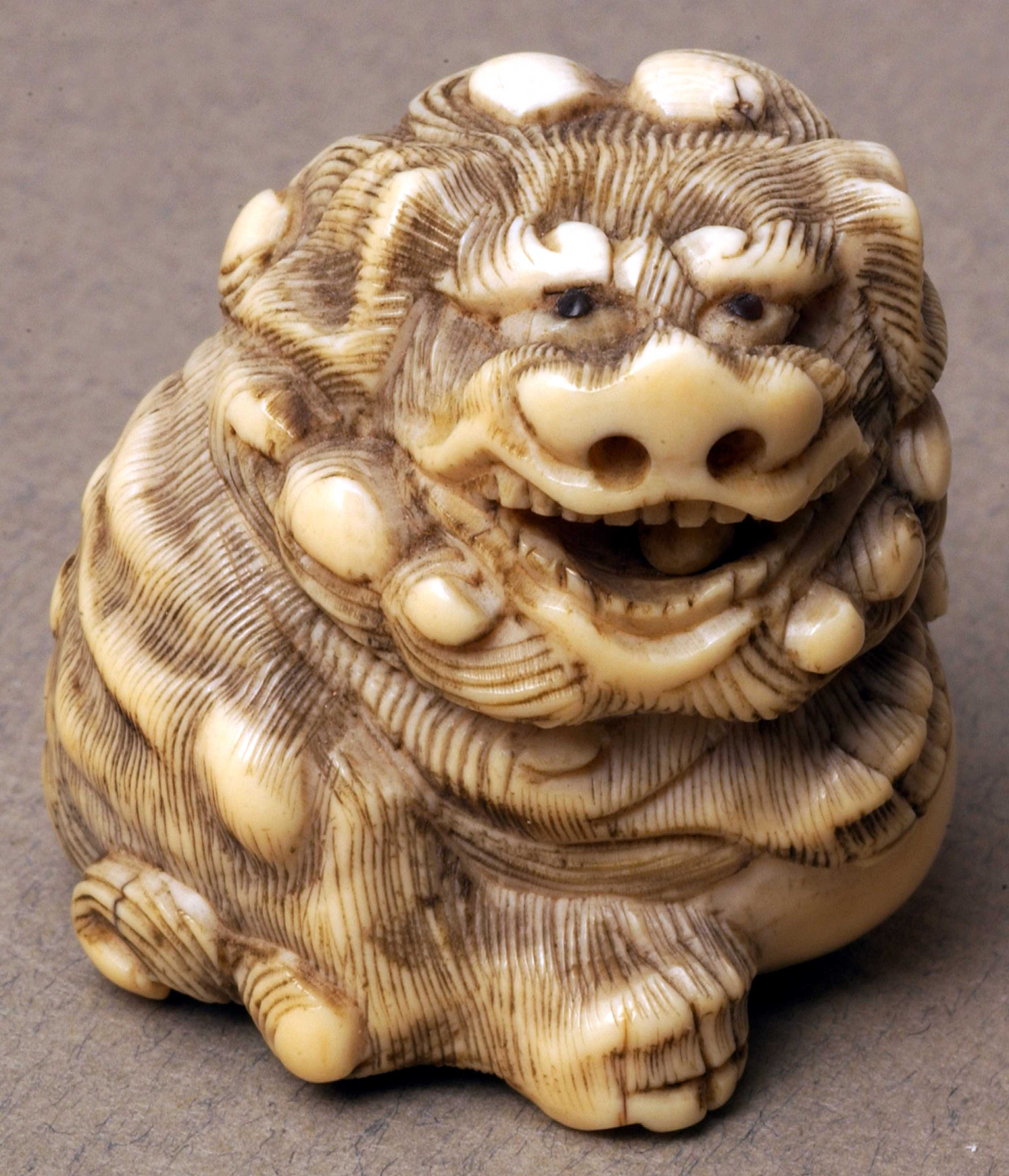 Netsuke depicting Shishi with ball
