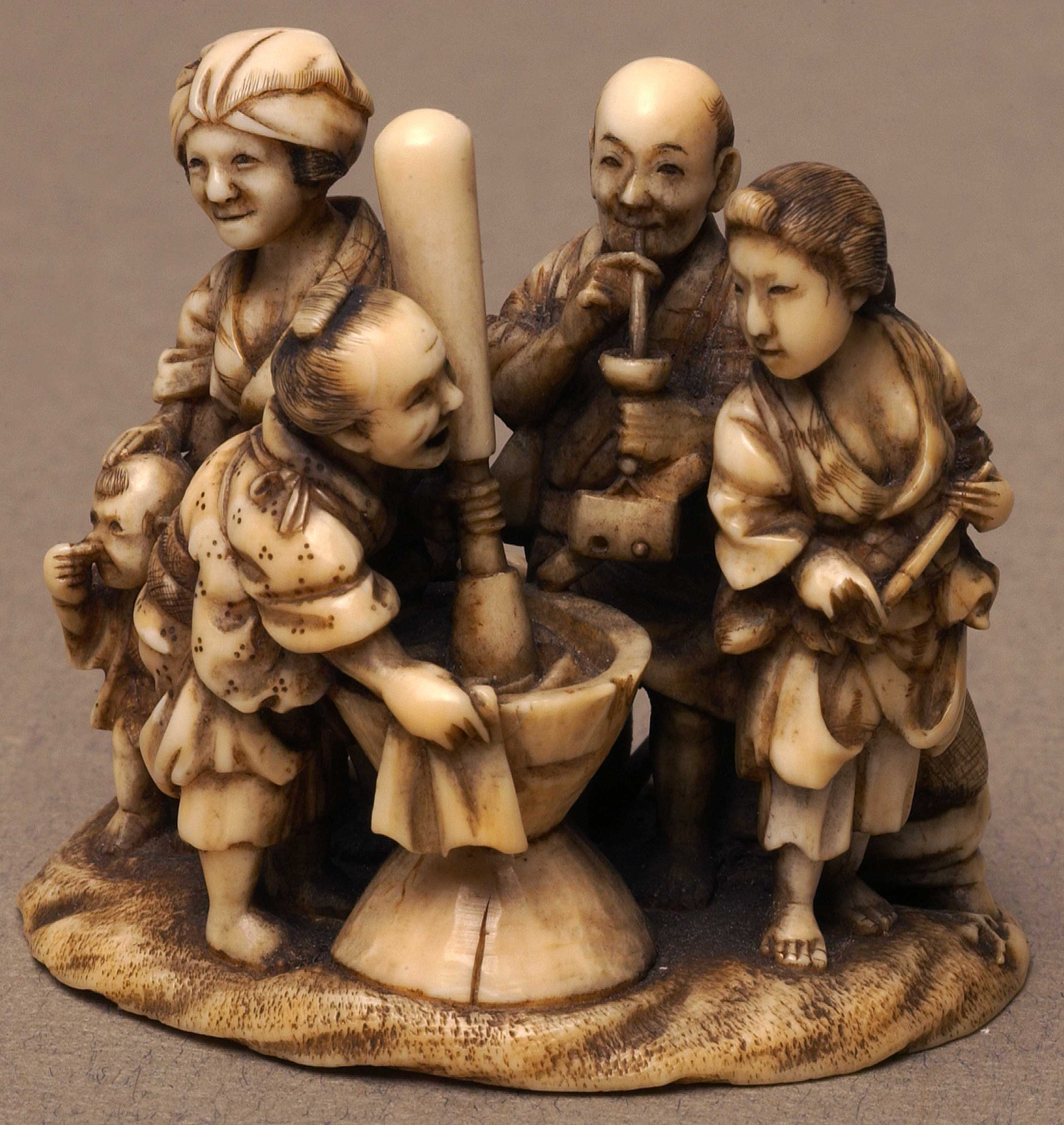 Netsuke depicting a family group of seven