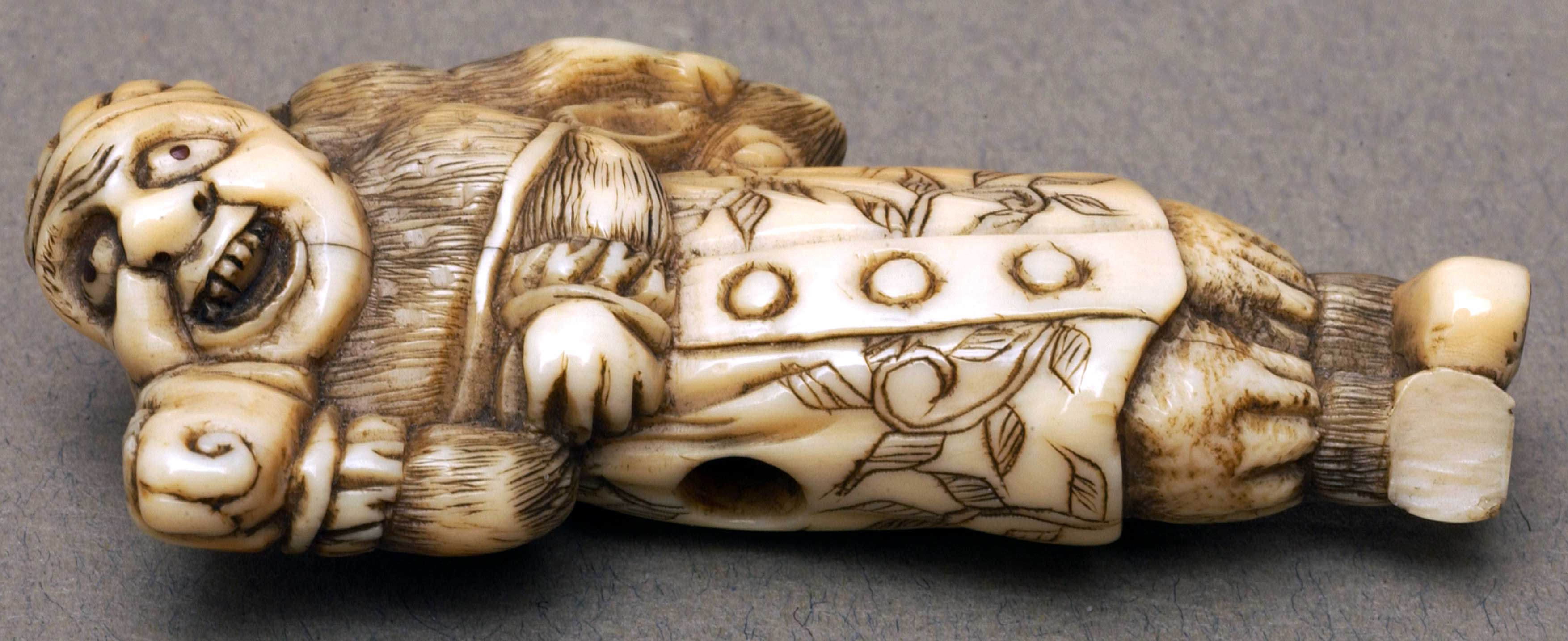 Netsuke depicting a man carrying a rabbit