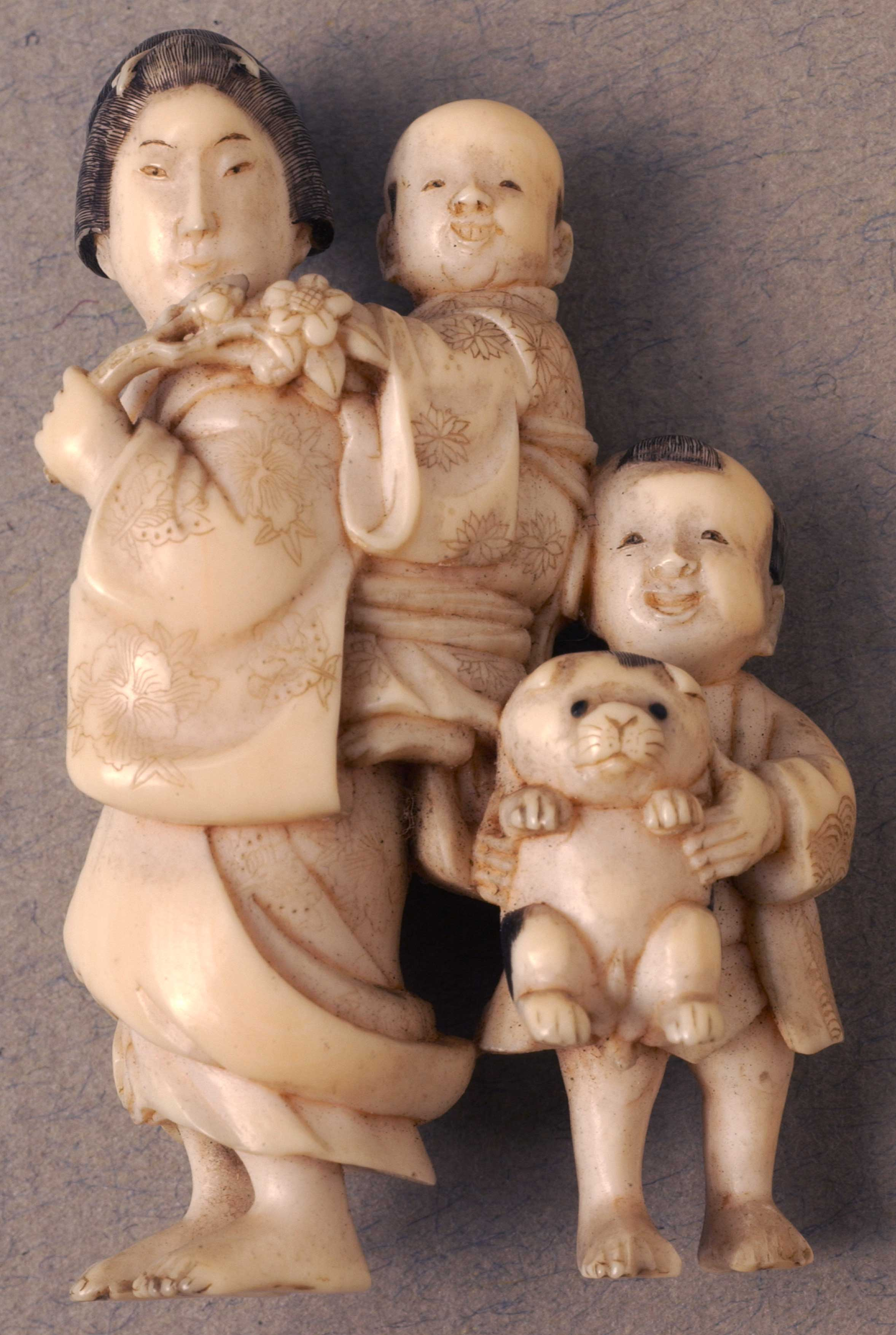 Netsuke depicting a Mother with two children