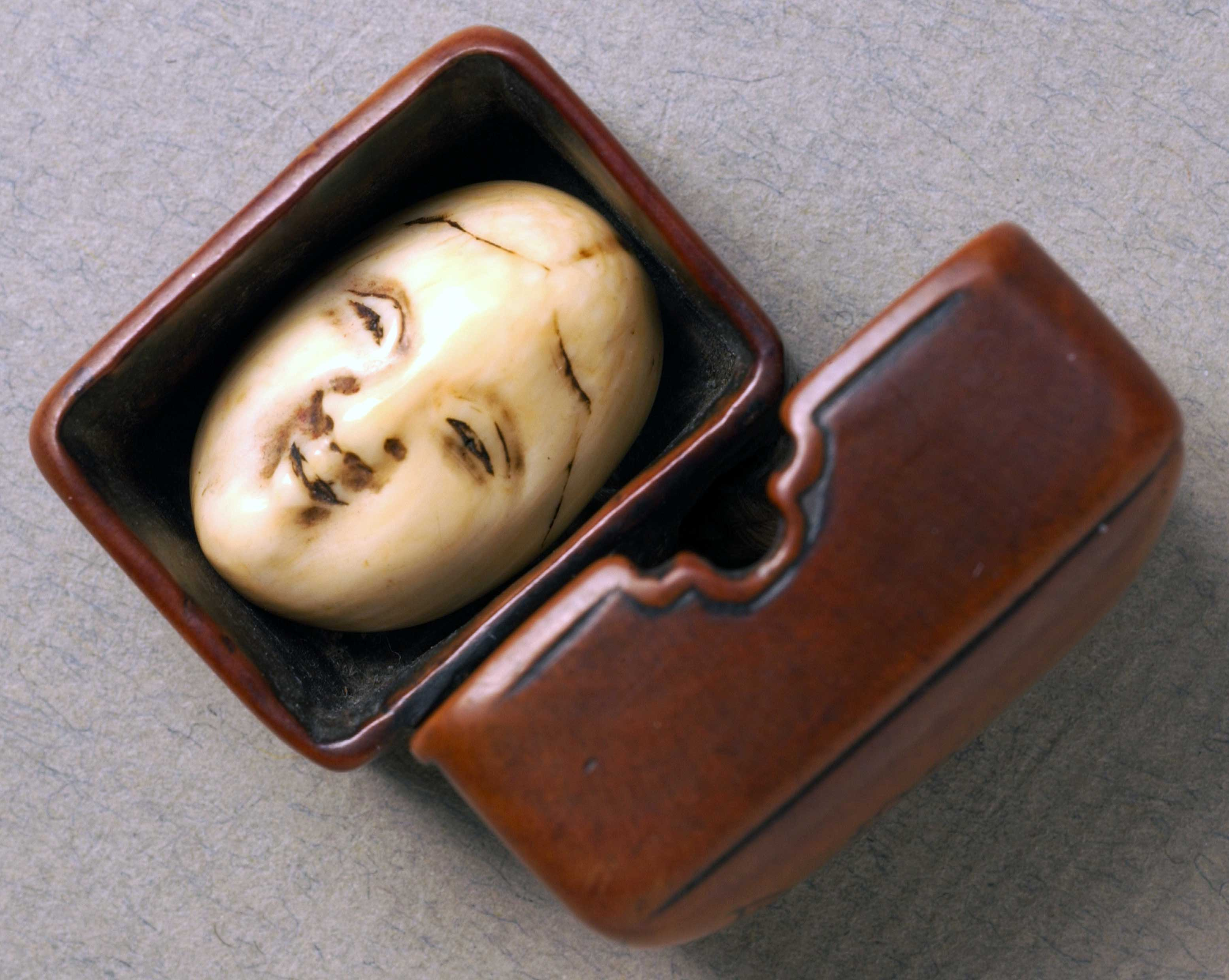 Netsuke in the form of an open box