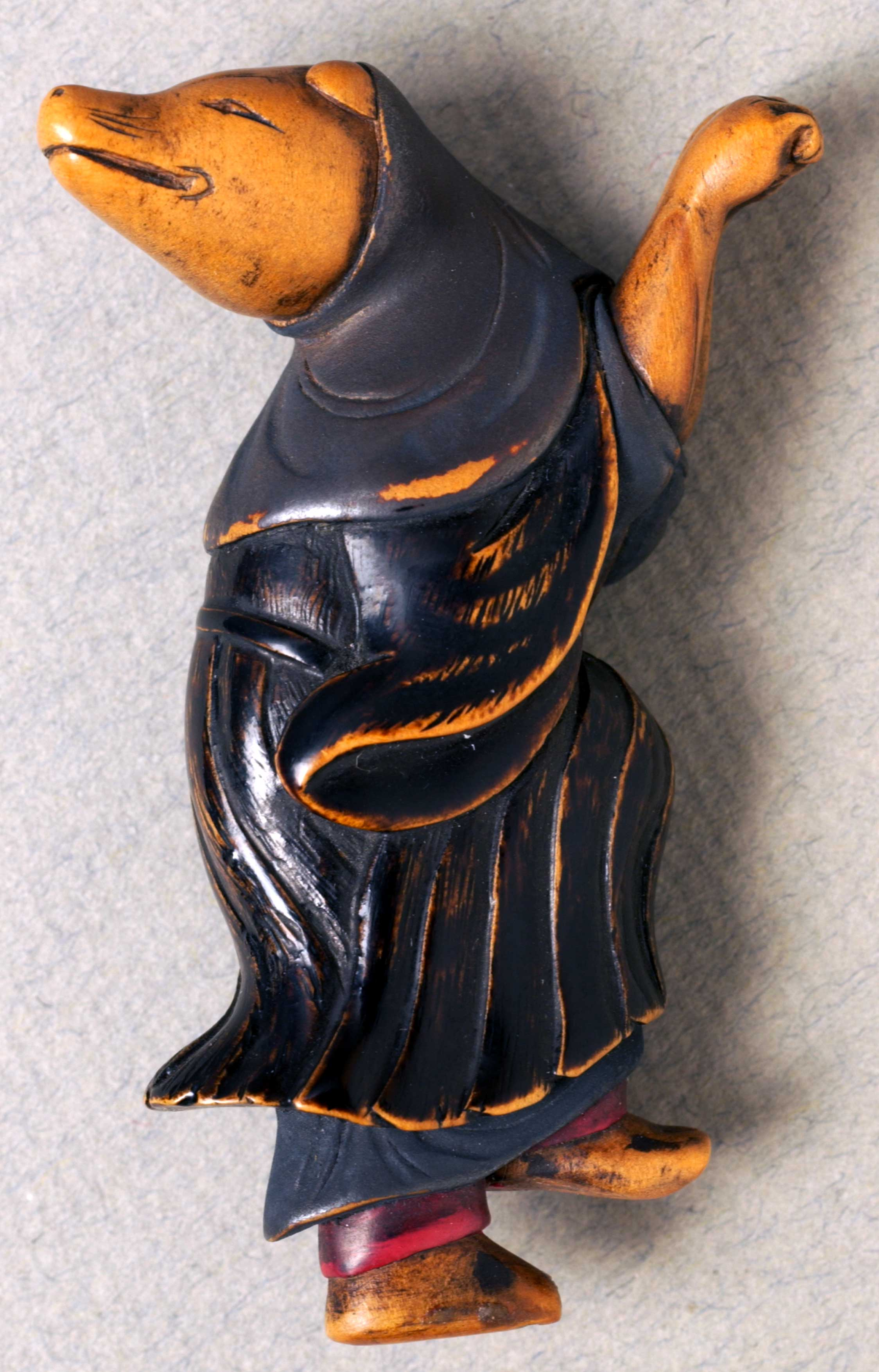 Netsuke depicting a clothed fox