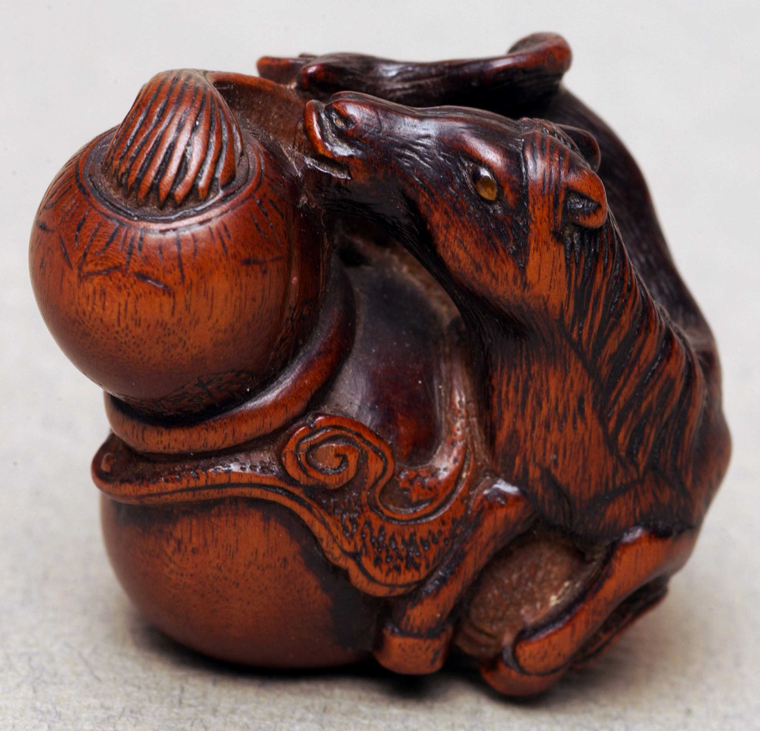 Netsuke depicting horse and gourd